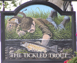The pub sign. The Tickled Trout, Wye, Kent