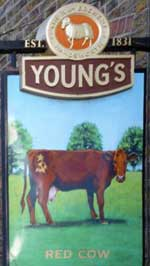 The pub sign. The Red Cow, Richmond, Greater London
