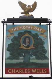 The pub sign. The Royal Oak, Bushey, Hertfordshire