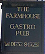 The pub sign. The Farmhouse, West Malling, Kent