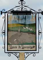 The pub sign. Hare & Hounds, Ashford, Kent