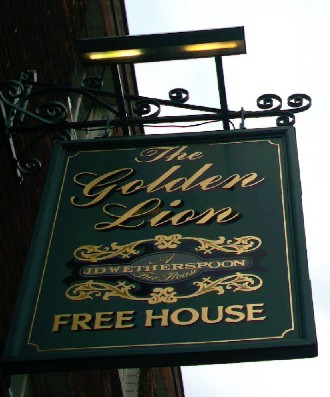 The pub sign. The Golden Lion Hotel, Rochester, Kent