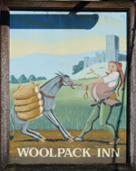 The pub sign. The Woolpack, Smeeth, Kent