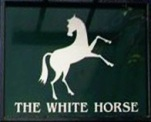 The pub sign. The White Horse, Parsons Green, Greater London