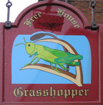 The pub sign. Grasshopper on the Green, Westerham, Kent