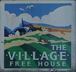 The pub sign. The Village Freehouse, Salisbury, Wiltshire