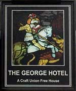 The pub sign. The George Hotel, Ashford, Kent