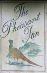 The pub sign. The Pheasant Inn, Higher Buwardsley, Cheshire