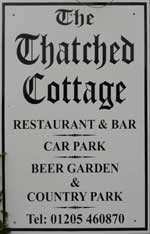 The pub sign. Thatched Cottage, Sutterton, Lincolnshire
