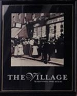 The pub sign. The Village, Walthamstow, Greater London