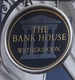 The pub sign. The Bank House, Cheltenham, Gloucestershire