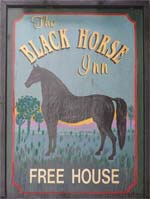 The pub sign. Black Horse, Walcote, Leicestershire