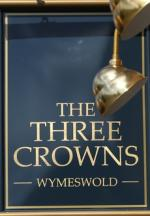 The pub sign. The Three Crowns, Wymeswold, Leicestershire