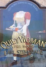 The pub sign. The Quiet Woman, Earl Sterndale, Derbyshire