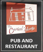 The pub sign. The Crooked House, Himley, West Midlands